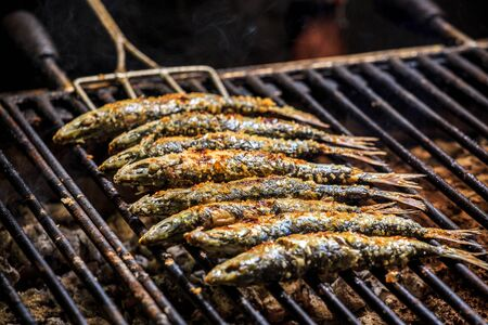 sardinas: Freshly grilled sardines on the grill, Portugal