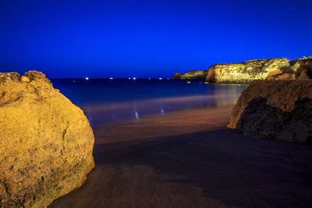 Lagos Beach with cliffs and fishermens boat, Algarve, Portugal