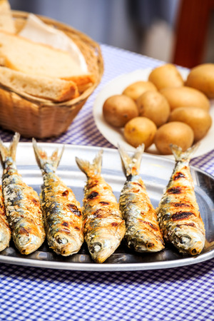 sardinas: Grilled sardines with salad, bread and potato, Portugal