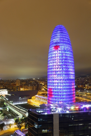 Illuminated Agbar Tower and city of Barcelona, Catalonia, Spain Editorial