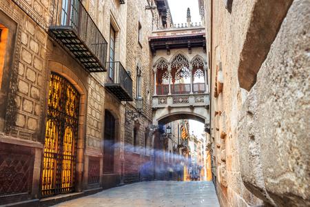 carrer: Bridge between buildings in Barri Gotic quarter of Barcelona, Spain