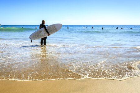 Surfers on Beliche Beach, Mediterranean Sea, Portugal Stock Photo