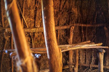 Bed in traditional, tribal hut of Kenyan people, Nairobi Stock Photo