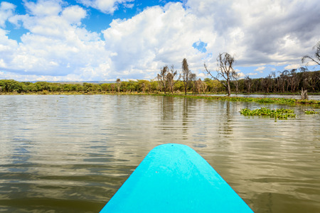 naivasha: Naivasha lake cruise by blue canoe, Kenya, East Africa Stock Photo