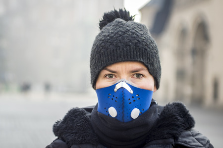 Woman using a mask, protecting herself from smog, Krakow, Poland Stok Fotoğraf