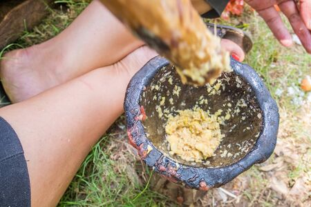 pestel: Grinding garlic and ginger in a mortar, Kenya