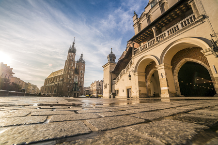 mickiewicz: Cloths Hall and Saint Marys Church on market square of Krakow, Poland, Europe