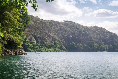crater lake: Chala Lake on the border of Kenya and Tanzania .A unique caldera lake, and is thought to be the deepest inland body of water in Africa.  Stock Photo