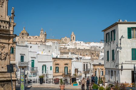 local 27: Ostuni, Italy -  February 27, 2017: Beautiful Ostuni with local people involved in discussion.