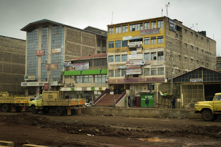 developing country: Nairobi, Kenya - December 2, 2016: Office building under construction and road leading to it Editorial