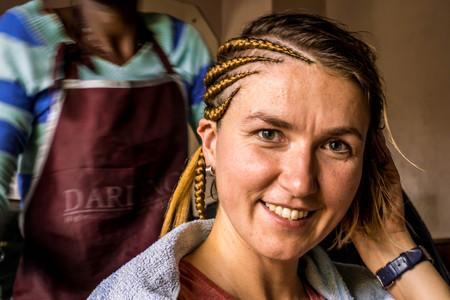 Braiding in hairdresser salon in Nairobi, Kenya, East Africa Reklamní fotografie