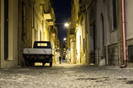 Narrow street of Brindisi at night, Puglia, Italy, Europe