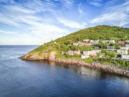 newfoundland: Small, wooden houses in hilly Petty Harbour, Newfoundland and Labrador, Canada Editorial