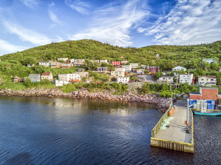 Beutiful Petty Harbour with two piers during summer sunset, Newfoundland and Labrador, Canada Editorial