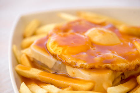 Francesinha - a Portuguese sandwich served with french fries, originally from Porto, Portugal Stock Photo