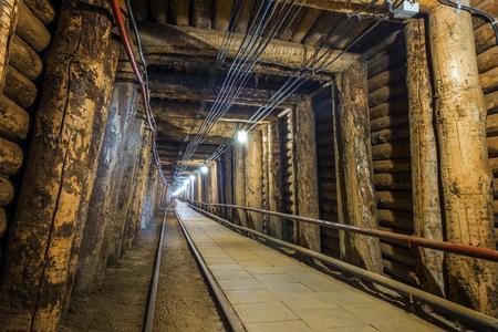 Illuminated underground tunnel in old, salt mine in Bochnia, Poland