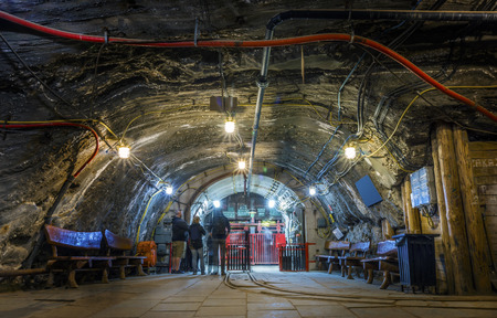 A few tourist waiting underground for the elevator, Bochnia salt mine, Poland Editorial