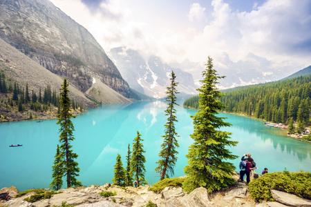 Tourists by Moraine Lake, Banff National Park, Alberta, Canada