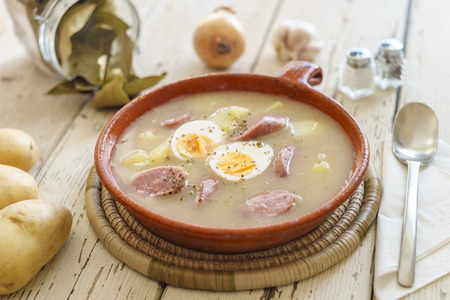 Traditional polish soup called Zurek with eggs and white sausage Stock Photo - 98099953
