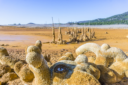 Gossan Reservoir with orange stalagmites on shore, Huelva, Andalusia, Spain