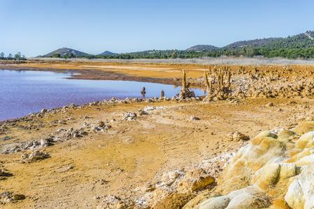 Gossan Reservoir with orange stalagmites on shore, Huelva, Andalusia, Spain