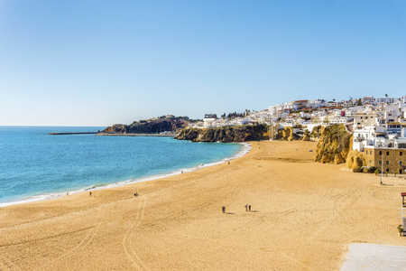 Amazingly wide, almost empty beach along cliffs in Albufeira, Algarve, Portugal