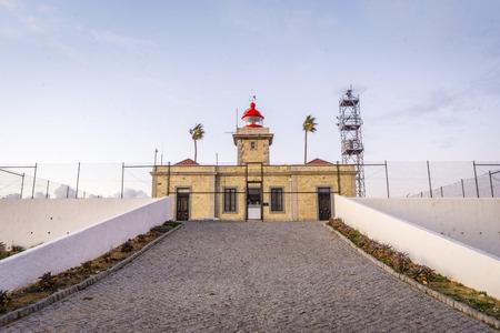 Lighthouse at sunset on Ponta da Piedade in Lagos, Algarve, Portugal Banco de Imagens