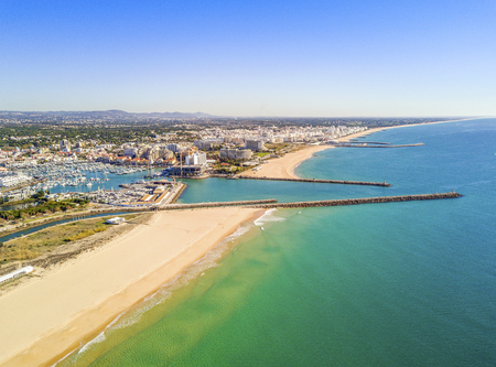 Aerial view of Vilamoura with charming marina and wide sandy beach, Algarve, Portugal