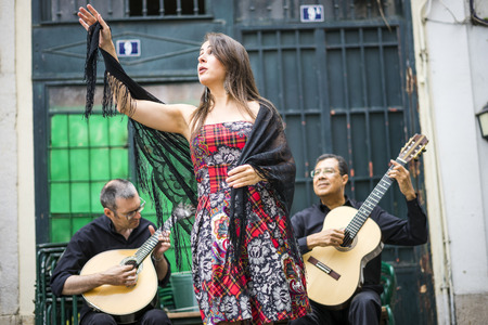 Fado band performing traditional portuguese music on the square of Alfama, Lisbon, Portugal Stok Fotoğraf