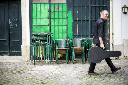 Musician with his beloved  portuguese guitar on the street of Lisbon, Portugal Stock fotó