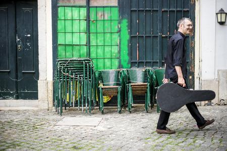 Musician with his beloved  portuguese guitar on the street of Lisbon, Portugal Reklamní fotografie