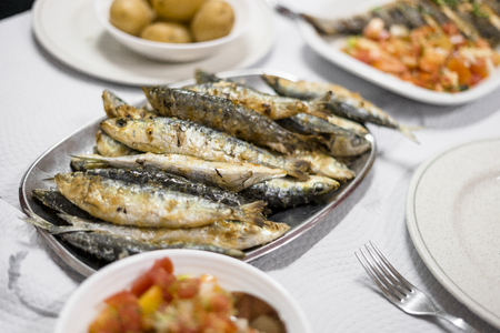 Grilled sardines served with salad and potatoes in the portuguese restaurant