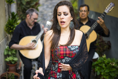 Fado band performing traditional portuguese music on the street of Alfama, Lisbon, Portugal Stok Fotoğraf