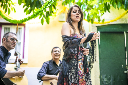 Fado band performing traditional portuguese music in the courtyard of Alfama, Lisbon, Portugal Stok Fotoğraf