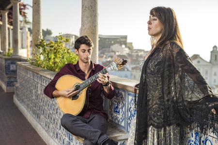 Band performing traditional music fado under pergola with portuguese tiles called azulejos in Lisbon, Portugal