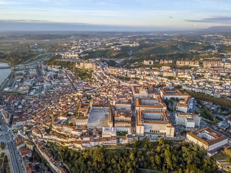 Aerial view of Coimbra with university at top of the hill at sunset, Portugal