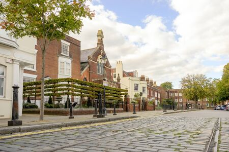 Street paved with cobblestones in historical old Portsmouth, Great Britain