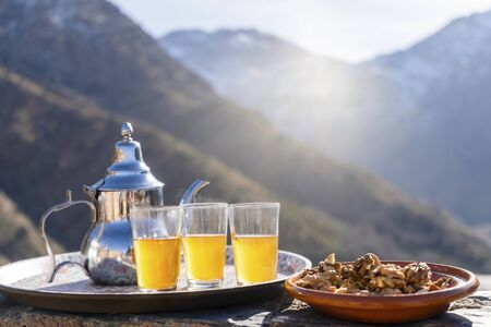 Famous Moroccan mint tea and silver kettle in High Atlas mountains, Aroumd