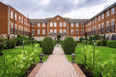 Big, old house made of brick with garden in the courtyard, Portsmouth, Great Britain