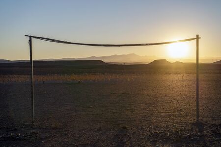 Wooden simple goals on the desert at sunset in Morocco