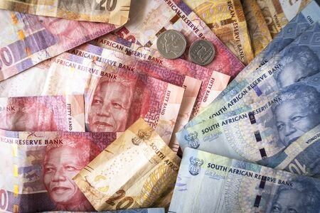 Banknotes and coins of South African currency called Rand
