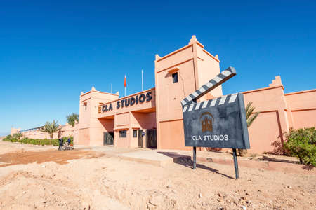Ouarzazate, Morocco - March 18, 2020: Main gate and advertising clipperboard of CLA Studios