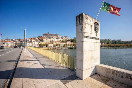 Coimbra cityscape with Santa Clara Bridge over Mondego river, central Portugal