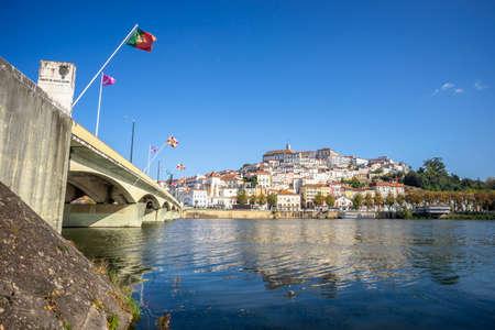 Coimbra cityscape with Santa Clara Bridge over Mondego river, central Portugal Stock fotó