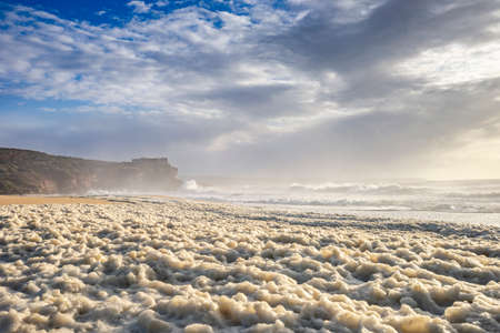 Restless sea at North Beach of famous Nazare, central Portugal