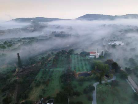 Rural landscape with fog and hills next to Estoi, Faro district, Algarve, Portugal