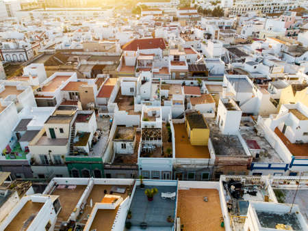 Aerial view of the cubist traditional architecture of Olhao by sunset, Algarve, Portugal