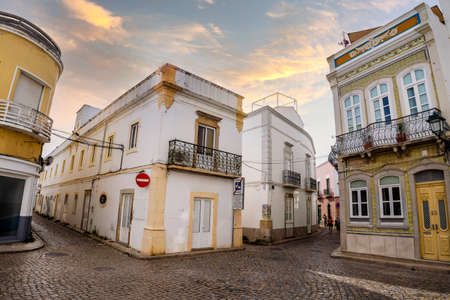 Narrow street with traditional fishermen's houses in Olhao, Algarve, Portugal