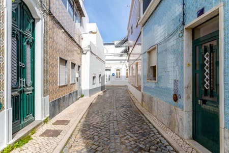 Narrow street with traditional fishermen's houses in Olhao, Algarve, Portugal Stock Photo
