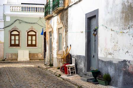 Narrow street of historic fishermen's town called Olhao, Algarve, Portugal